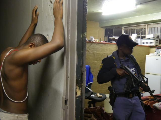 Man waits for armed police to search his room